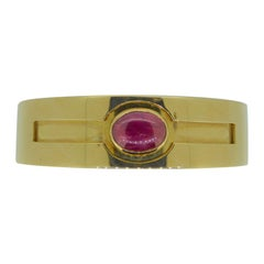 Bulgari Cabochon Ruby and 18 Carat Yellow Gold Hinged Bracelet Bangle