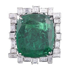 Set in 18K, 30.88 cts, natural Zambian Emerald & Baguette diamonds cocktail Ring