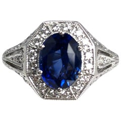 2.02 Carat Oval Cut Fine Blue Sapphire and Diamond Ring in 18 Karat White Gold