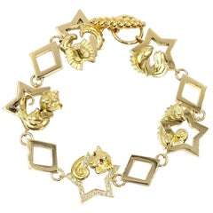 18 Karat Vintage Star Animal Charm Bracelet with Diamonds and Rubies