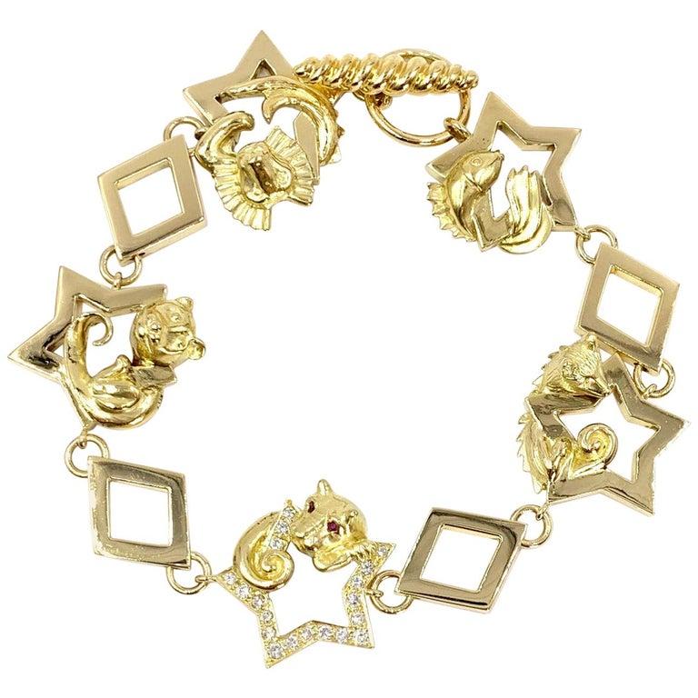 18 Karat Vintage Star Animal Charm Bracelet with Diamonds and Rubies For Sale
