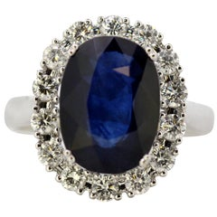 Vintage 18 Karat White Gold Ring with Natural Blue Sapphire and Diamonds