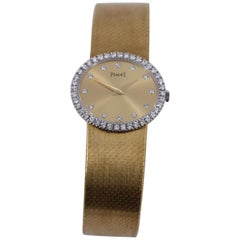 Yellow Gold Piaget Watch with Diamond Bezel and Diamond Markers