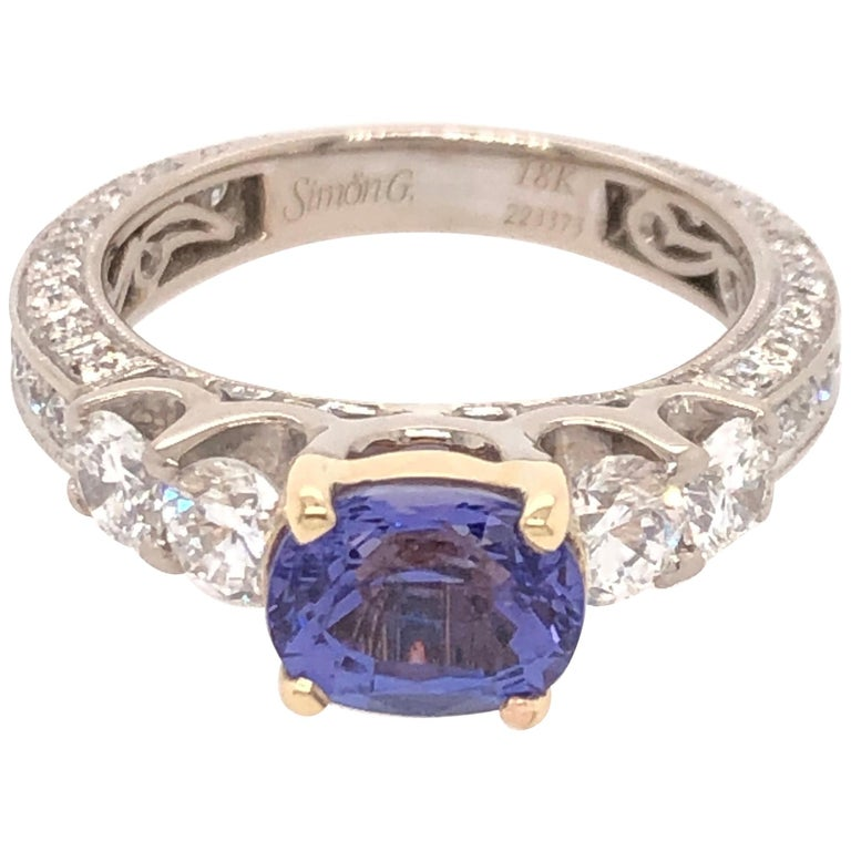 Oval Tanzanite Diamond White Gold with Yellow Gold Basket Ring For Sale