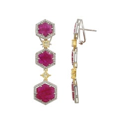 Set in 18K gold, natural Mozambique Ruby and Princess Yellow Diamond Earrings