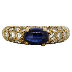 Cartier 18 Karat Gold Ring with Cabochon Blue Sapphire and Diamonds