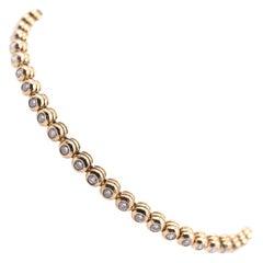 18 Karat Yellow Gold Bezel Set Diamond Tennis Bracelet