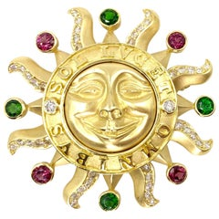 18 Karat Sun Brooch with Diamonds and Tourmaline Gemstones