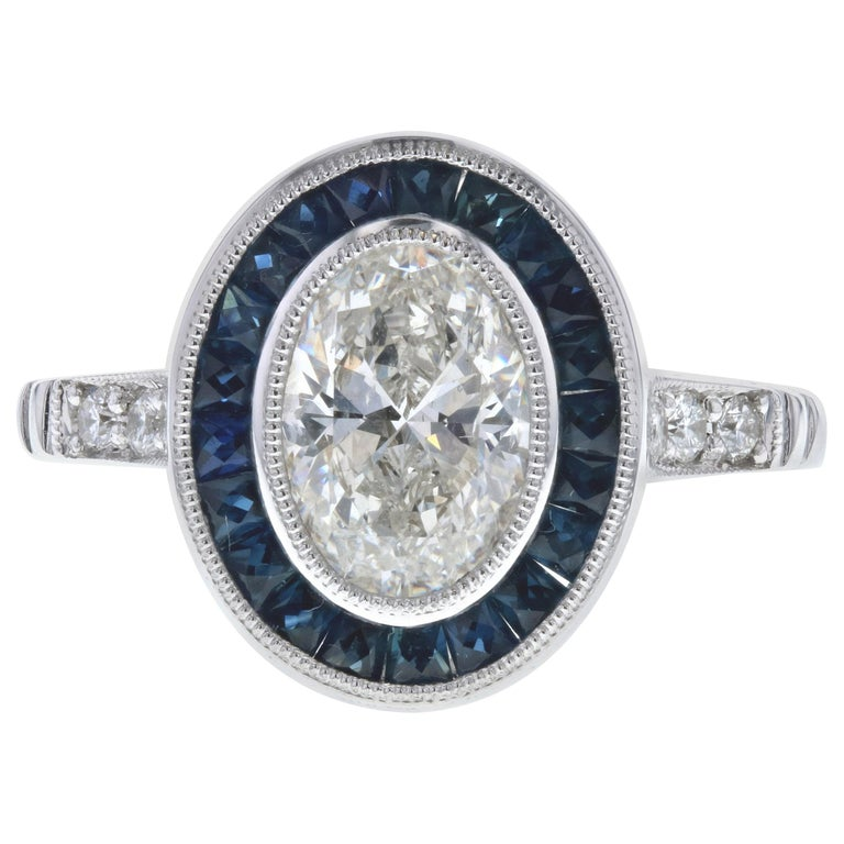 Vintage Inspired Oval Diamond Engagement Ring with Blue Sapphires