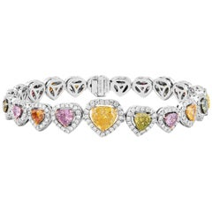 GIA Certified Fancy Yellow Pink 7.78 Carat Natural Colored Diamond Bracelet