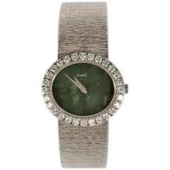 Ladies White Gold Piaget Watch with Oval Shaped Jade Dial and Diamond Bezel