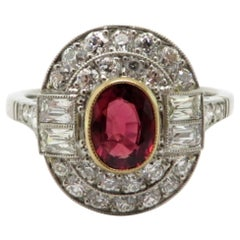 Platinum and 18 Karat Ruby and Diamond Art Deco Style Halo Ring
