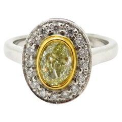 Estate Yellow Oval Diamond Halo 18 Karat Yellow Gold and Platinum Ring
