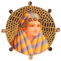 Typical Late 19th Century Gold Enameled Brooch with Bedouin Woman