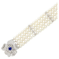 Four Strand Cultured Pearl, Platinum, Diamond and Sapphire Flower Bracelet