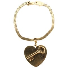 Vintage 1960s 14 Karat Gold Heart Charm Bracelet by Tiffany & Co.