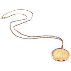 14 Karat Yellow Gold Chain and Liberty Coin Pendant