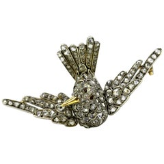 Antique Victorian 18k gold bird brooch with natural ruby and old cut diamonds