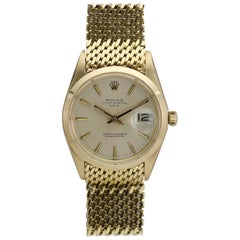 Rolex 18 Karat Yellow Gold Date Ref 1500 on Rolex Gold Mesh Bracelet, circa 1969