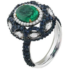 Studio Rêves 1.73 Oval Emerald with Diamonds and Blue Sapphire Ring in 18K Gold