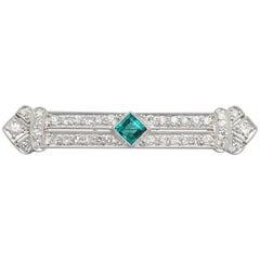 1930s Emerald 1.29 Carat Diamond Platinum Brooch