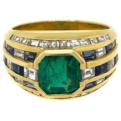 18 Karat Yellow Gold Diamond Emerald and Sapphire Ring