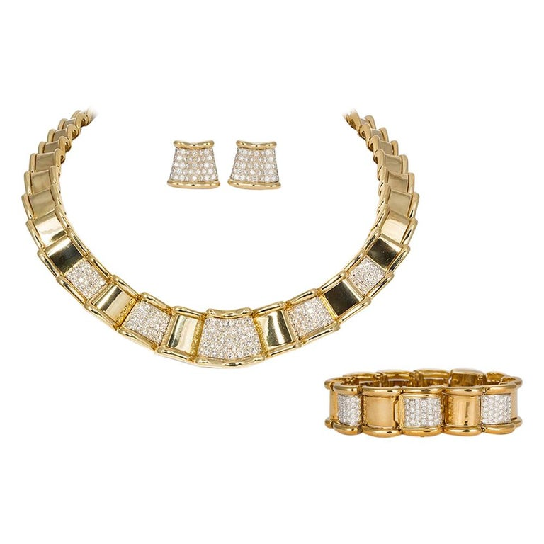 Moboco 18 Karat Yellow Gold and Diamond Ribbon Jewelry Set For Sale