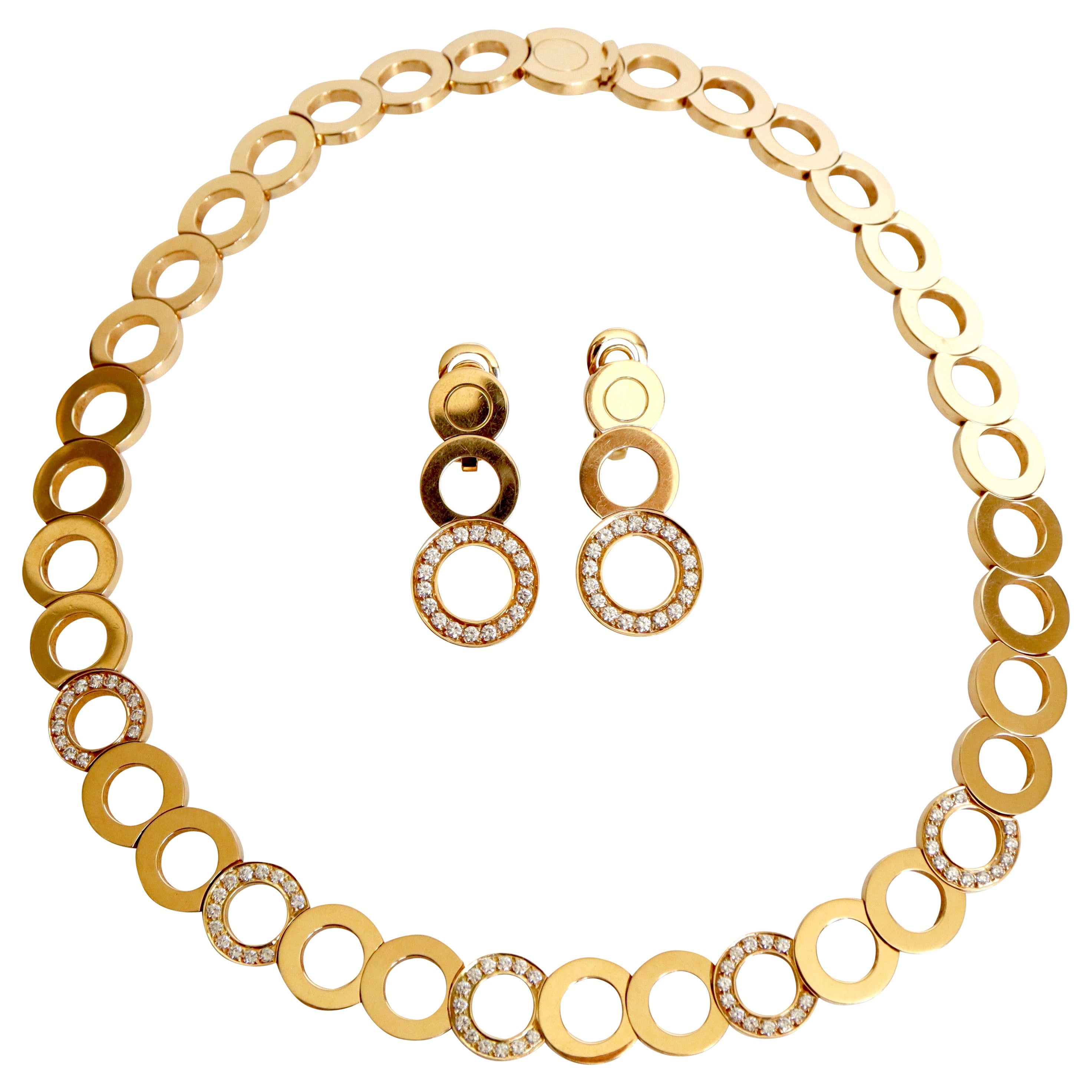 O.J. Perrin Set of a Necklace and Earrings in 18 Carat Gold and Diamonds