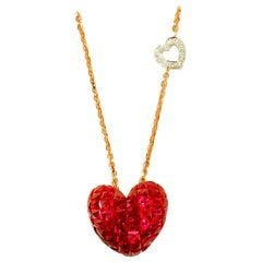 18 Karat Rose Gold Ruby and Diamond Heart Pendant in Invisible Setting