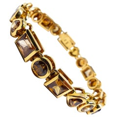 20 Magnificent Zirkons in Different Shapes Set in a Bracelet in 18 Karat Gold