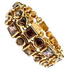 40 Magnificent Zirkons in Different Shapes Set in a Bracelet '2rows' in 18K Gold