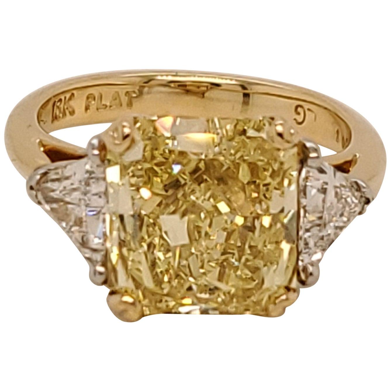 GIA Certified Radiant Cut 5.01 Carat Fancy Intense Yellow Three-Stone Ring
