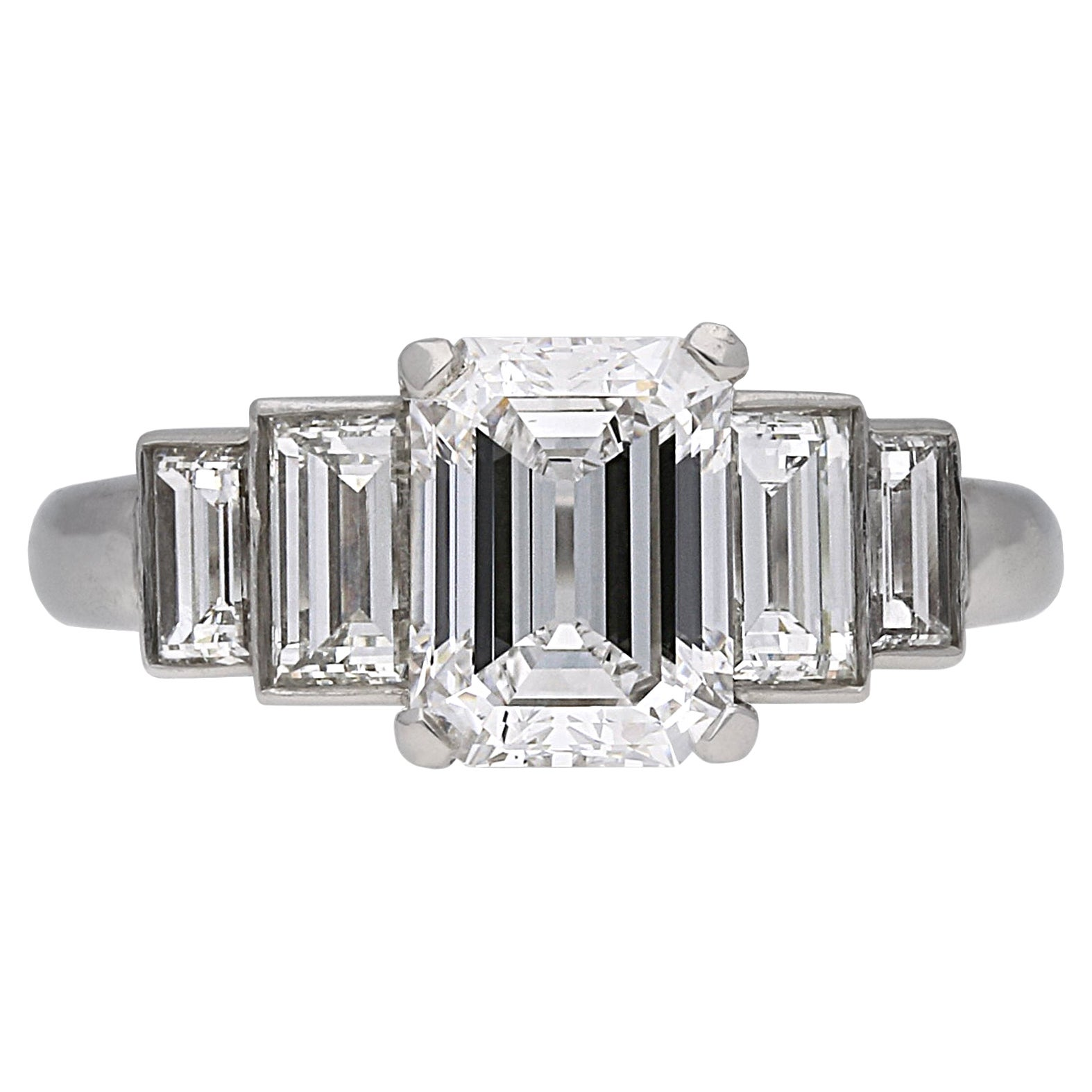 Vintage Emerald-Cut Diamond Flanked Solitaire Ring, circa 1950