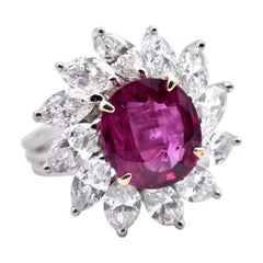 Platinum Ruby and Marquise Diamond Halo Ring