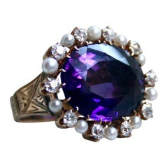 Outstanding Antique 14 Karat Gold Amethyst Ring with Diamond and Pearl Halo