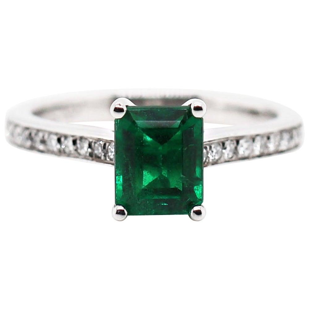 1.36 Carat Emerald Cut Emerald and Diamond Platinum Engagement Ring