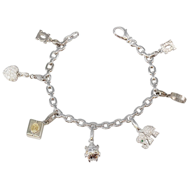 cartier diamond gold charm bracelet at 1stdibs