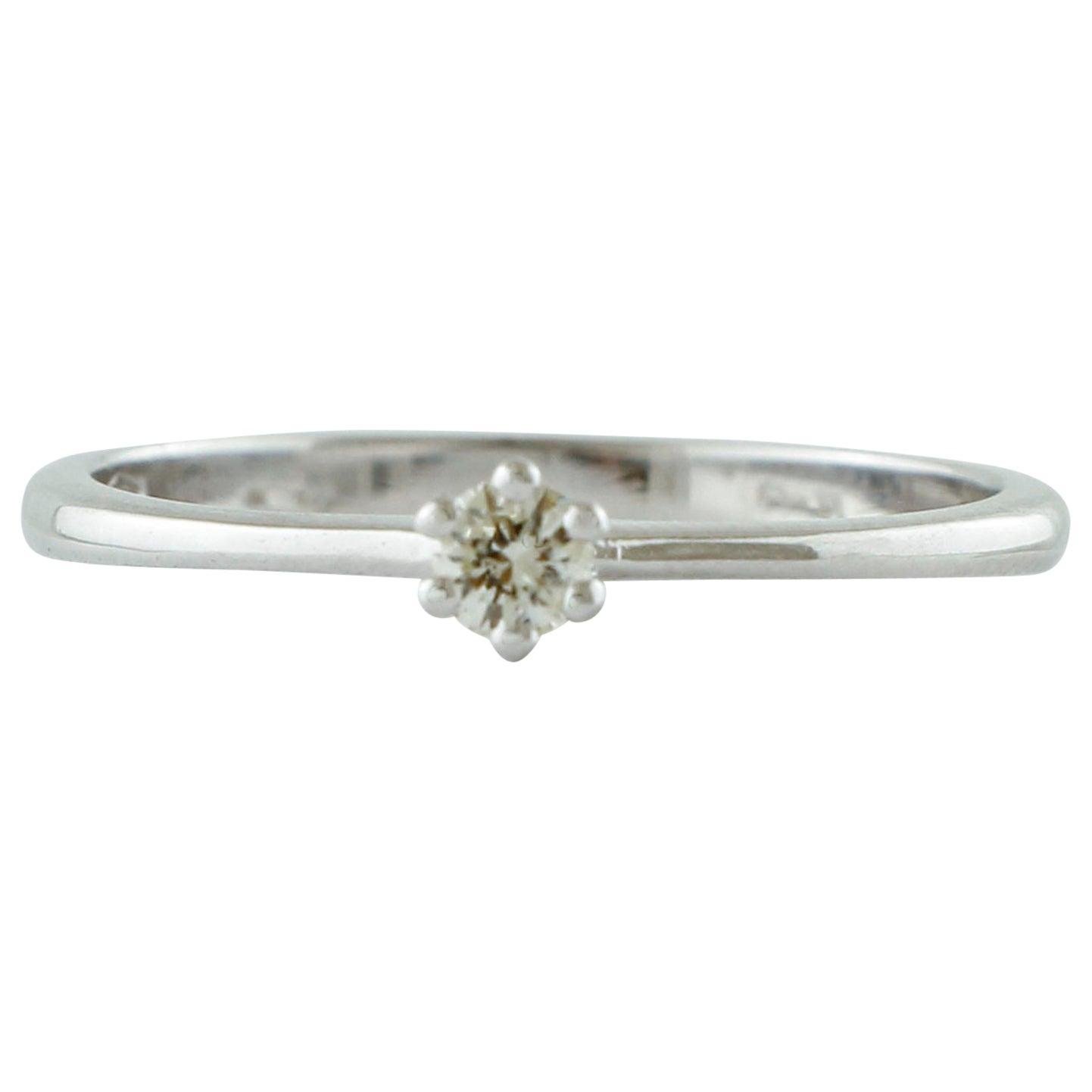 Diamond, 18 Karat White Gold Solitaire/ Engagement Ring