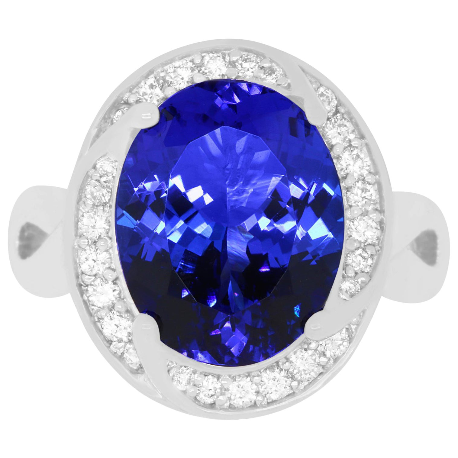 6.31 Carat Oval Shaped Tanzanite and 0.31 Carat White Diamond Ring
