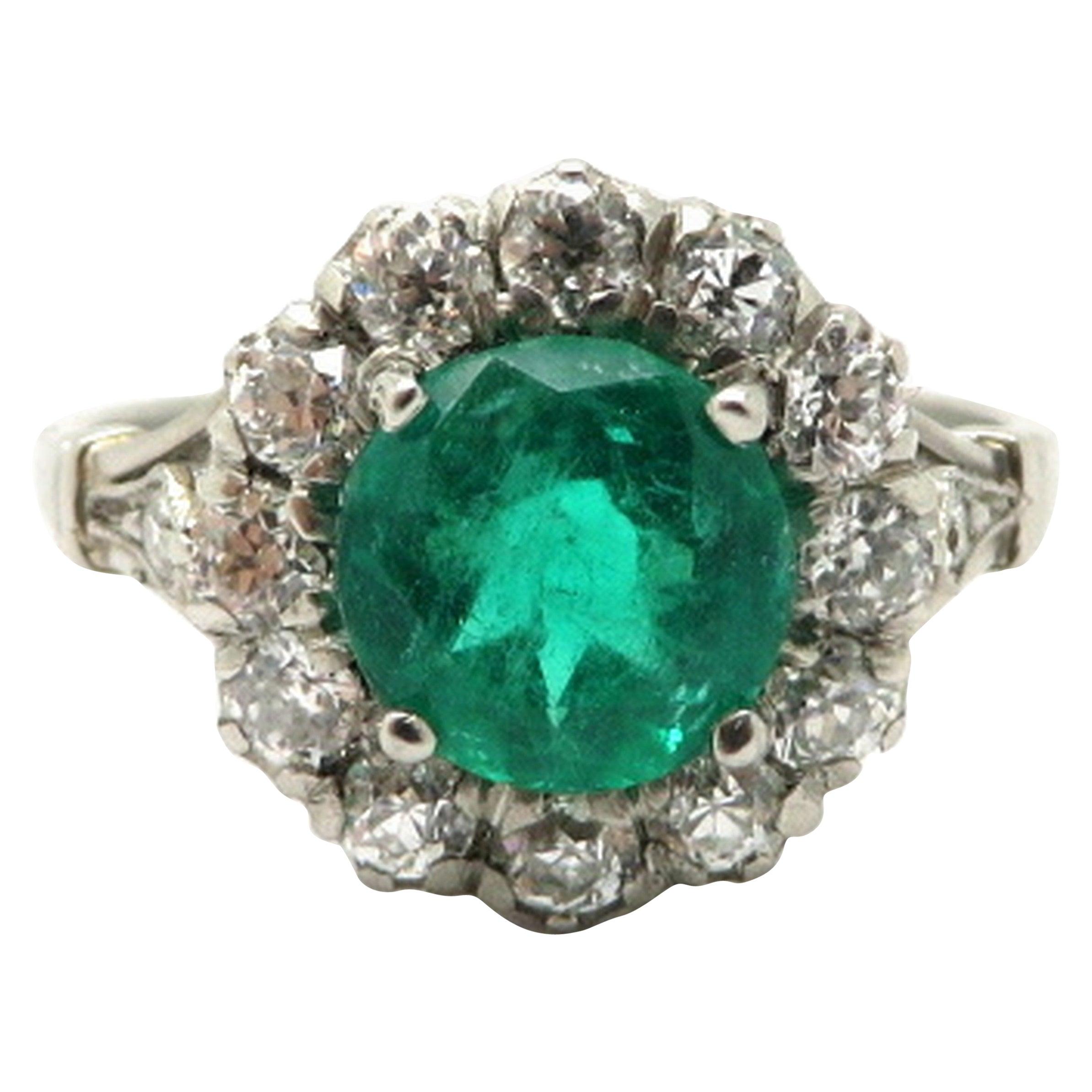Platinum Estate Round Emerald and Diamond Halo Engagement Ring