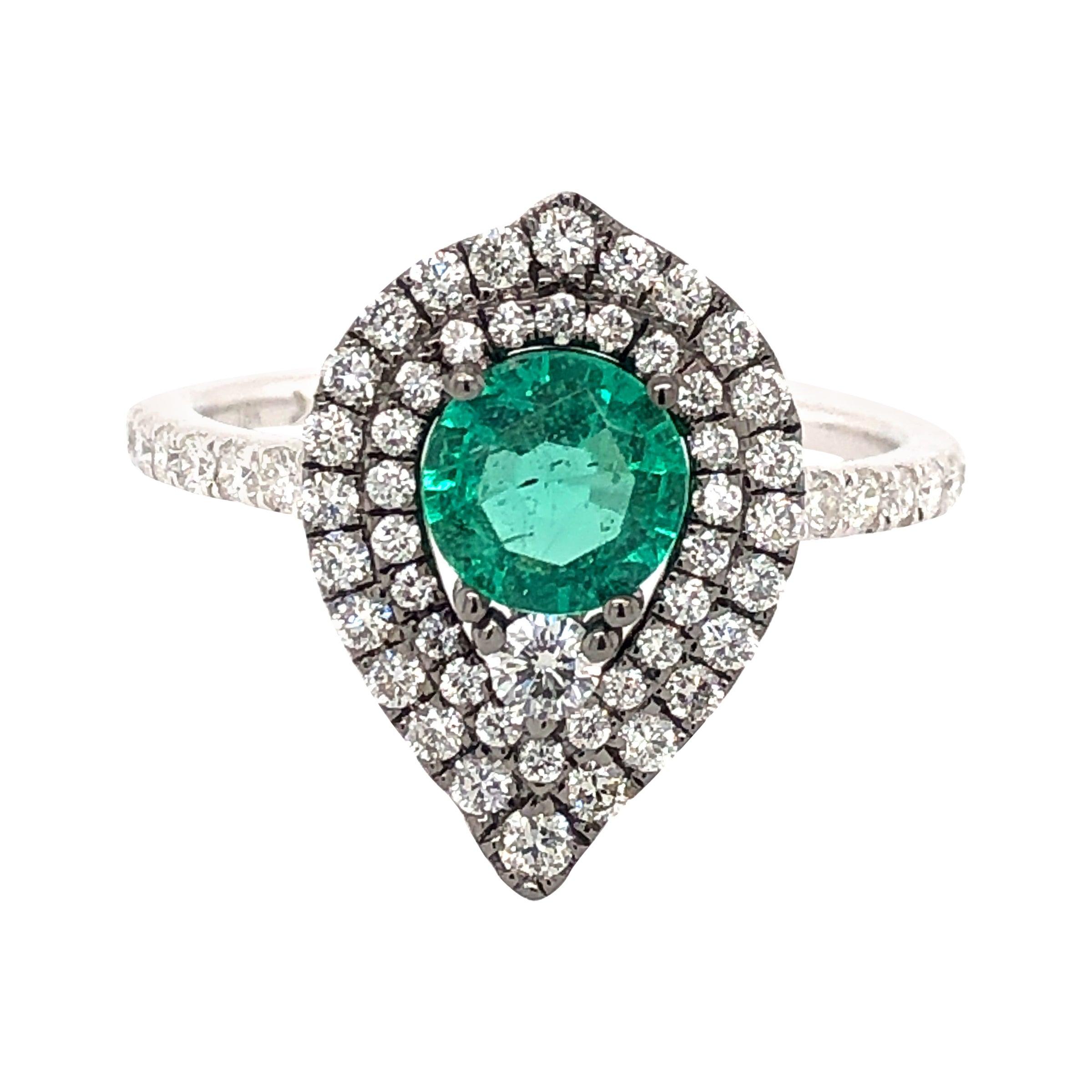 0.63 Carat Emerald and Diamond Ring