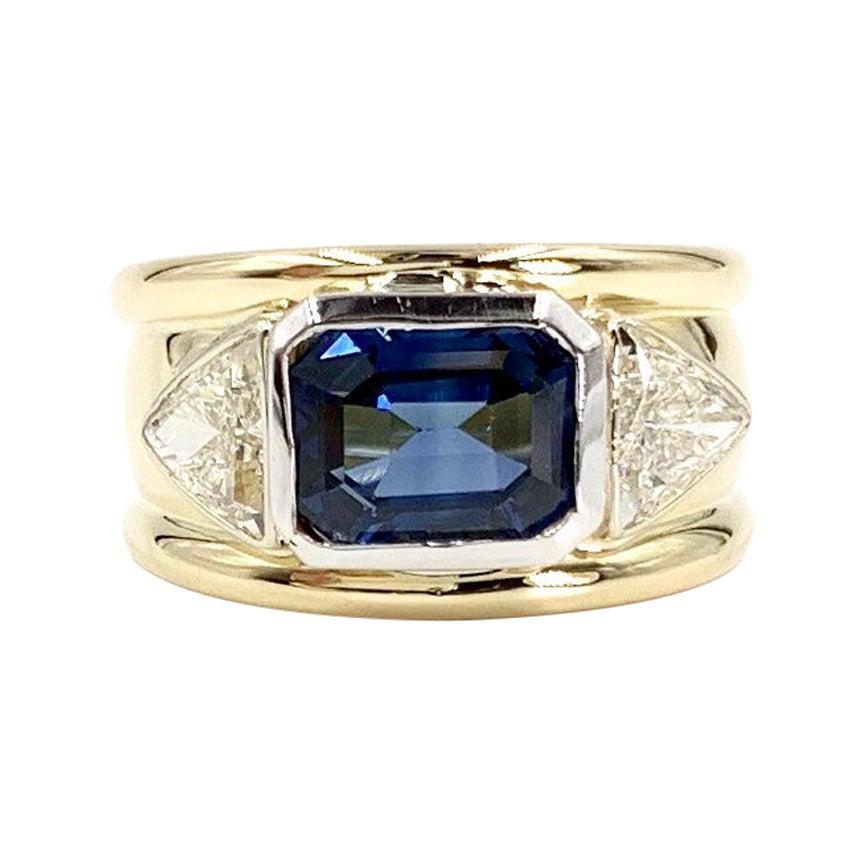 18 Karat and Platinum Three-Stone Blue Sapphire and Diamond Wide Ring