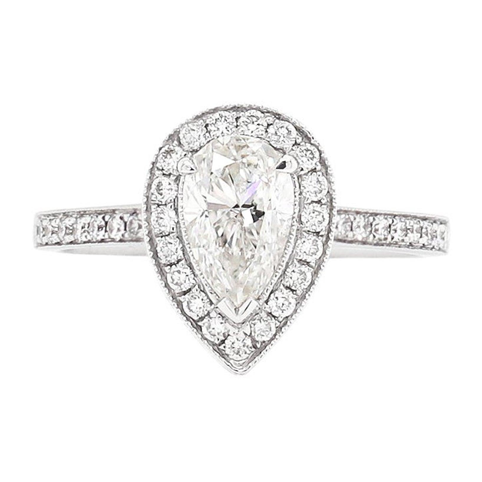1.01 Carat G SI1 Pear Shape Diamond Halo 18 Carat White Gold Engagement Ring