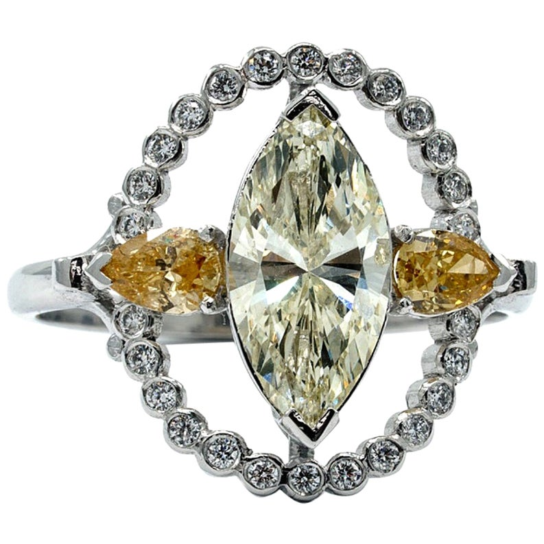 Marquise Halo Ring in 18 Karat White Gold with White and Yellow Diamonds