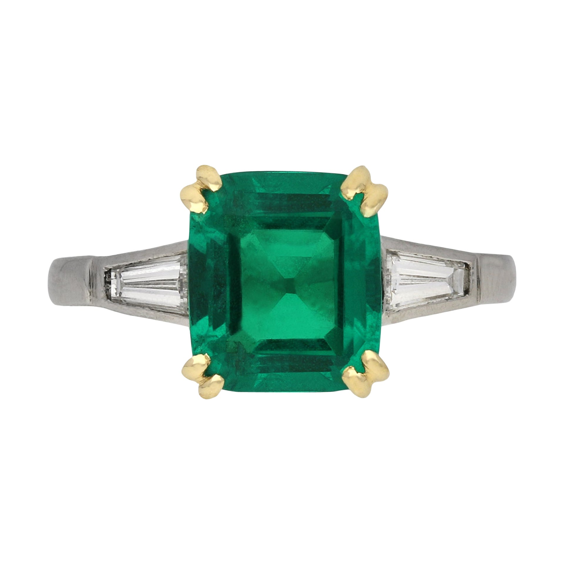 Colombian Emerald and Diamond Flanked Solitaire Ring, circa 1950
