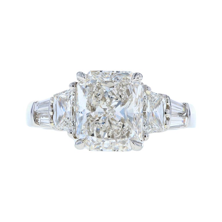 Three -Stone Radiant Cut Diamond Engagement Ring with Trapezoid Side Stones