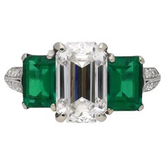Diamond and Natural Unenhanced Emerald Three-Stone Ring
