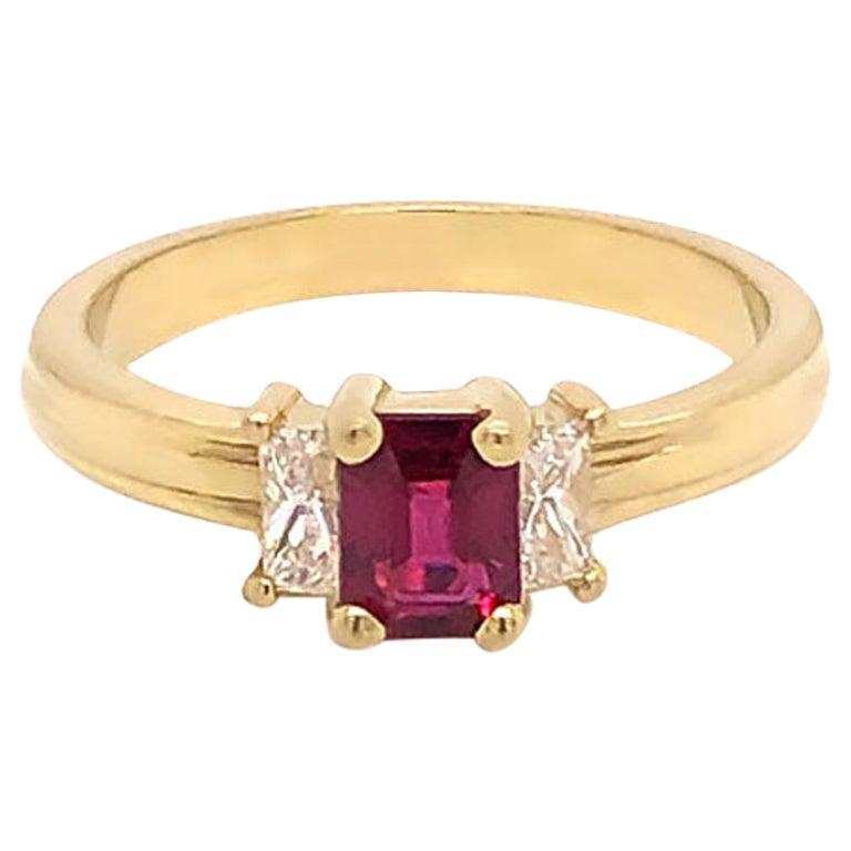 Ruby and Diamond Three-Stone Ring in 18 Karat Yellow Gold