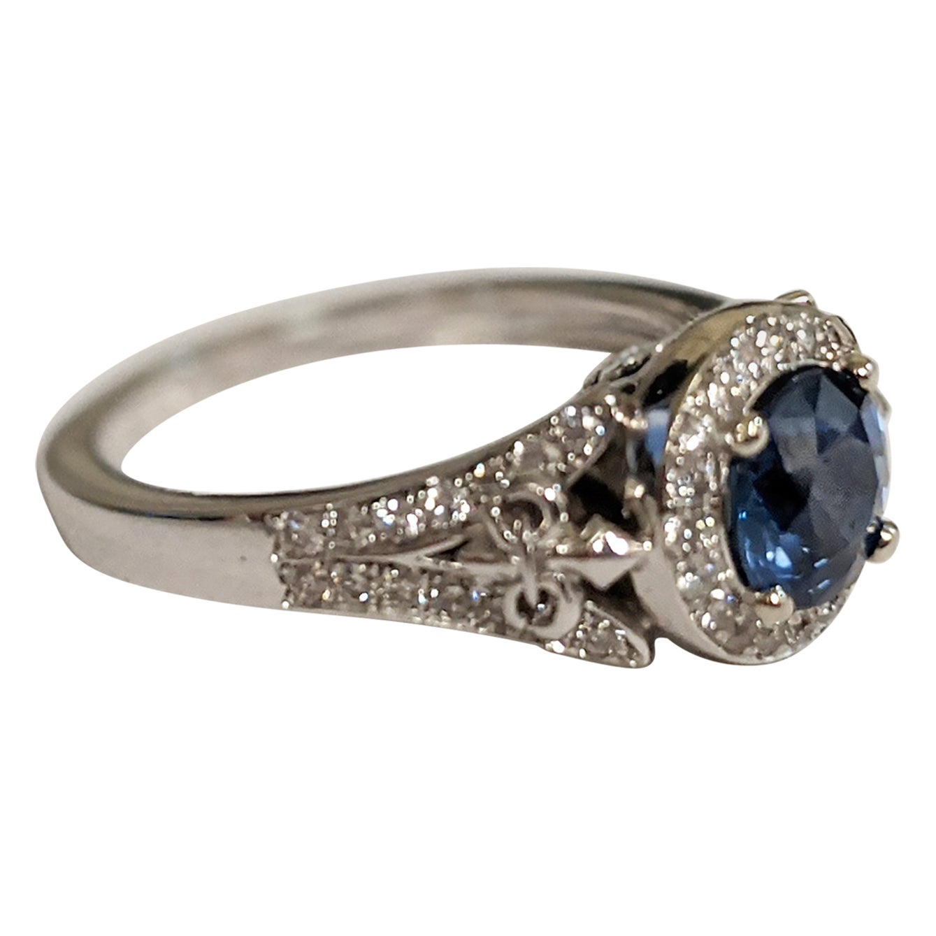 Round-Cut Sapphire Ring with Diamond Halo and Details