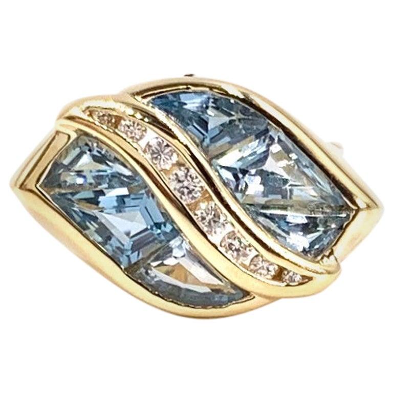 Yellow Gold Sky Blue Topaz and Diamond Modern Ring